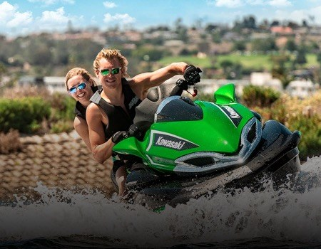 2 riders on a kawasaki jet ski